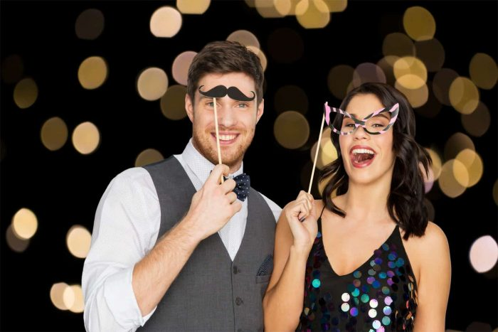 Couple with Props in Photo Booth