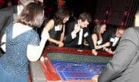 Employees at craps table of corporate sponsored casino theme party
