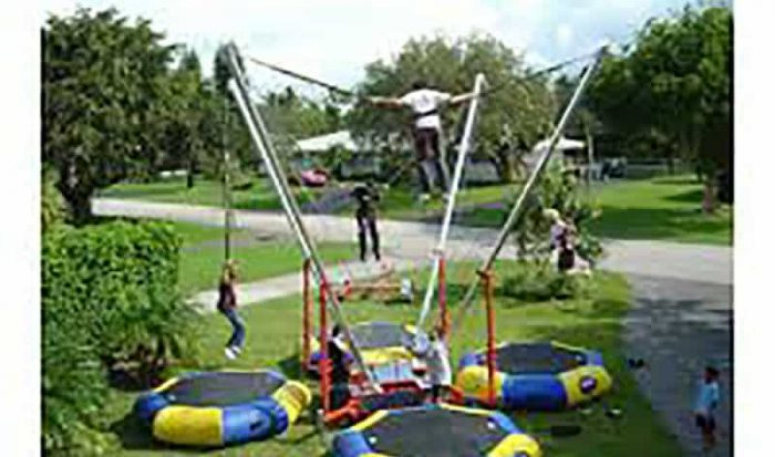 Example of 4 people on the 4-person Euro Bungee Rental at a carnival party.