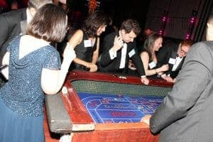 Casino Party Goers Enjoying Craps Table
