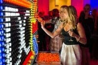 example of two women using the Giant Light Brite at an company event