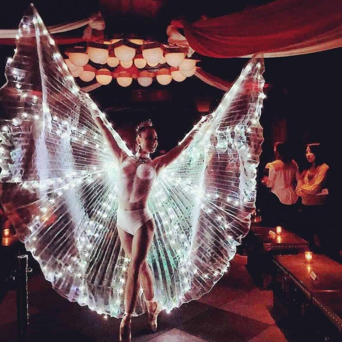 Beautiful woman performer in LED Butterfly Outfit